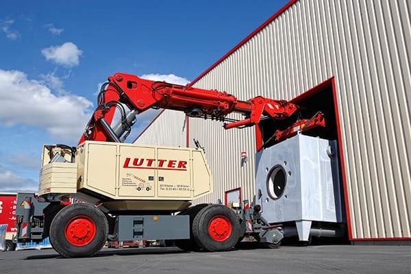 Lutter Spedition NRW - Betriebsumzüge - Maschinentransport - Logistik - Verladung von Maschinen mit Bakran